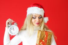 Girl Holding An Alarm Clock Stock Images