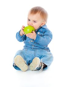 Baby With Green Apple Stock Images