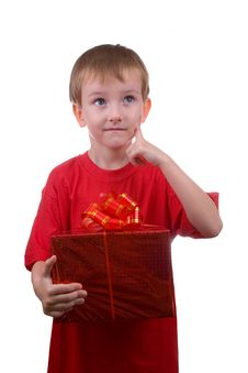 Free Happy Boy Thinks About The Gift Stock Images - 16222234