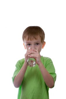 Free Boy Drinks Water From A Glass Royalty Free Stock Photo - 16222295