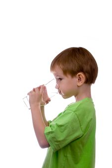 Boy Drinks Water From A Glass
