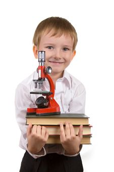 Happy Boy With A Stack Of Books Royalty Free Stock Images