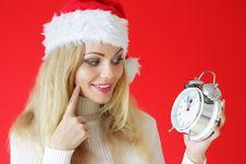 Santa Girl Holding Alarm Clock Royalty Free Stock Images