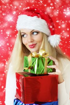 Free Santa Girl Holding Gifts Stock Photography - 16223302