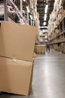 Free Cardboard Boxes In The Aisle Royalty Free Stock Images - 16223539