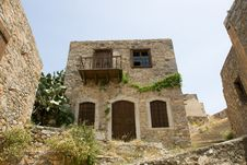 Picturesque Old Double-decker Lopsided Stone House Stock Images