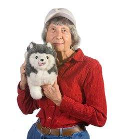 Free Old Woman Holding Stuffed Animal Royalty Free Stock Image - 16225606