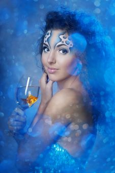 Free Girl With Makeup, With A Fish In A Glass Stock Images - 16227024