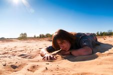 Free Girl Playing With Sand 2 Stock Image - 16228171