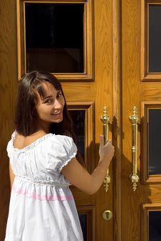 Young Attractive Girl At The Door Royalty Free Stock Photography