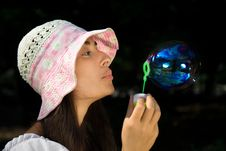 Free Young Girl In The Bonnet Blowing Bubbles Stock Image - 16228751