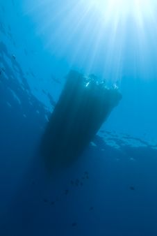 Underwater View Of Boat Silhouette With Sunrays. Royalty Free Stock Photo
