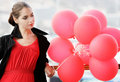 Free Upset Young Woman With Red Balloons Stock Photo - 16239880