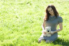 Girl Sitting On Green Grass Royalty Free Stock Images