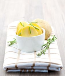 Free Potato Sliced With Rosemary Stock Image - 16231261