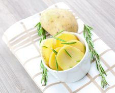 Free Potato In Bowl With Rosemary Stock Images - 16231284