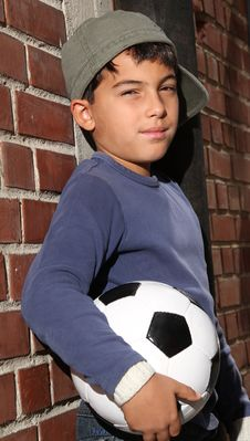 Male Kid With A Football Royalty Free Stock Images