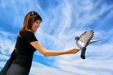 Free Girl Feeds The Dove Stock Image - 16234911