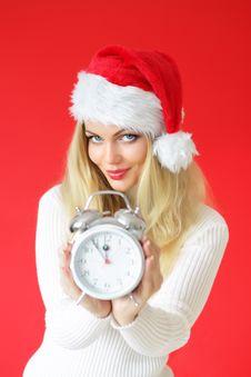 Santa Girl Holding Alarm Clock Royalty Free Stock Photos