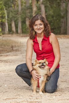 Girl With Dog Walking On The Park. Stock Photo