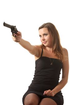 Free Girl Is Aiming A Revolver Stock Photos - 16239433