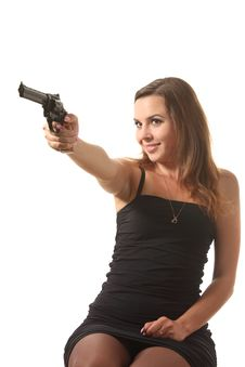 Free Girl Is Aiming A Revolver Royalty Free Stock Photography - 16239437