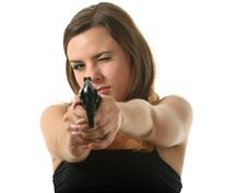 Free Girl Is Aiming A Revolver Royalty Free Stock Photo - 16239455