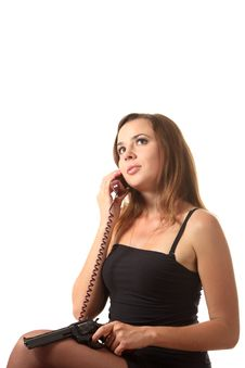 Free A Girl With Revolver Speak By Phone Stock Image - 16239471