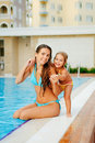 Free Portrait Of Mother And Her Daughter Near Pool Stock Images - 16240874