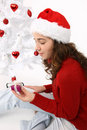 Free Hand Holding A Christmas Gift Stock Images - 16247254