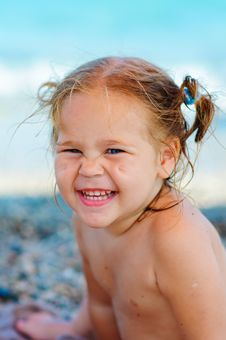 Free Cute Toddler Girl On Sea Background Royalty Free Stock Photography - 16240857