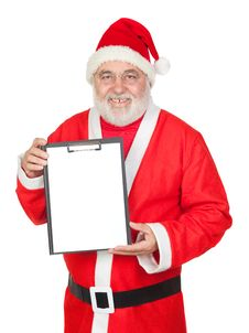Smiley Santa Claus With A Blank Clipboard Stock Photos