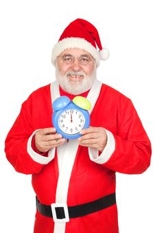 Smiley Santa Claus With Alarm Clock Stock Photos