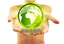 Hands Holding Earth With Green Leafs