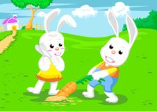 Couple Rabbits And Big Carrot Royalty Free Stock Photo