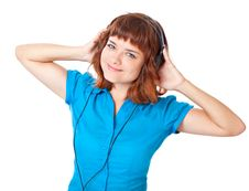 Free Young Red-haired Girl Listen To Music And Dance Stock Photography - 16244972