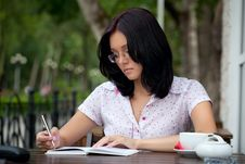 Free Girl With Notepad In Cafe Stock Image - 16245731