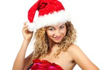 Young Girl  In Santa Claus Hat Royalty Free Stock Photos