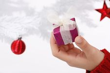Free Hand Holding A Christmas Gift Stock Photos - 16247123