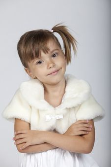 Successful Elegant Little Girl With Arms Crossed Stock Photo