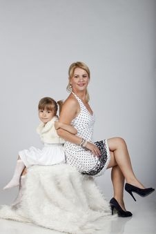 Beautiful Young Mother And Daughter Posing Stock Photo
