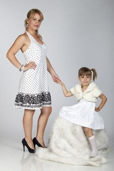 Beautiful Young Mother And Daughter Posing Royalty Free Stock Photo