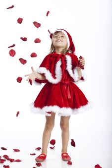 Free Happy Little Santa Girl And Flying Rose Petals Stock Photography - 16248952