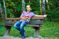 Handsome Guy With Bouquet Waiting For His Girlfrie Royalty Free Stock Photography