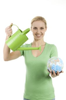 Free Young Woman Watering The Earth Royalty Free Stock Photography - 16251577