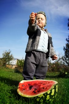 The Boy Presses A Water-melon Hands Royalty Free Stock Images