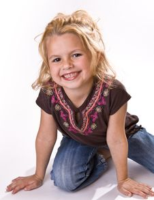 Free Adorable Smiling Little Girl On Her Knees Stock Image - 16252621
