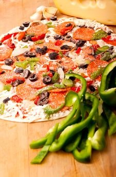 Free Raw Pizza With Vegetables And Pepperoni Stock Photos - 16253453