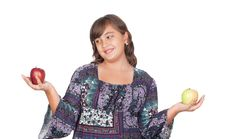 Free Adorable Preteen Girl With Two Differents Apples Stock Photos - 16256713