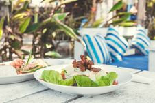 Free Caesar Salad On A White Wooden Table In The Beach Cafe, Bali Island. Royalty Free Stock Photography - 162501777